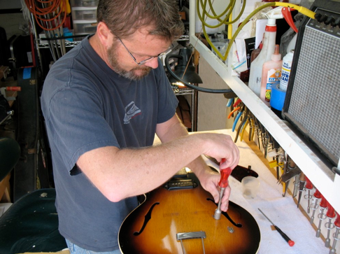 Jim Crawford prepping an archtop for a re-fret and set up.